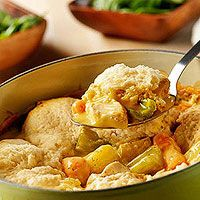 The slow-cooker simmers chicken, potatoes, carrots, and celery in a creamy sauce and is topped with tender dumplings made easy and delicious with baking mix.