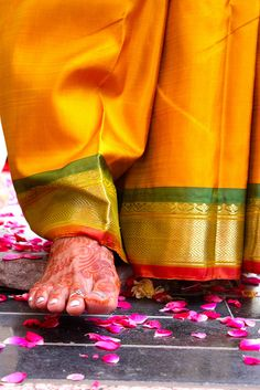 Ceremony by Bride while taking first step In husbands house. India.