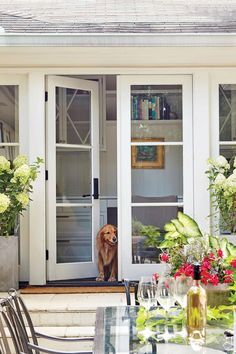 "The Patio Doors Open Up the Exterior - A Dramatic Ranch House Renovation - Southernliving. ""Ranches tend to have ceilings and not a lot of natural light, making them feel cramped,"" Evans notes. Architecture Renovation, Pavillion, Front Door Makeover, Exterior Makeover, French Doors Patio, French Patio, Front French Doors, Farmhouse Patio Doors, Modern Patio Doors"