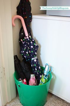 Add a bucket to the garage/mudroom to store umbrellas.
