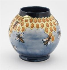 Lot 352 - `Honeycomb` a Moorcroft Pottery vase designed by Philip Richardson, ovoid, painted in shades of
