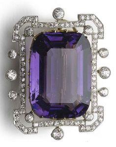 An Edwardian amethyst and diamond brooch, circa 1910.