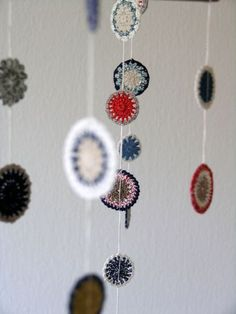 mobile.  love it....    could make w/ not crochet, since i don't know how...and do linen circles w/ embroidery....hmmm...thinking back to the mobiles i made when R was a baby....