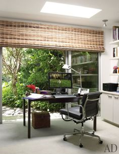 Judy Blume's Key West, Florida, Getaway : Blume's guest-cottage office is furnished with an Artemide table lamp, a vintage Dunbar desk, and an Eames chair by Herman Miller; the window shade is by Conrad.