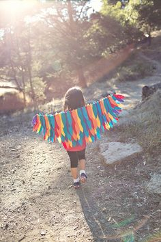 Have a fun family dress up day by making this easy No-Sew DIY Rainbow Bird Wings Costume!