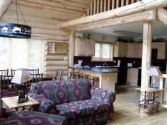 Bluff View Cabin has a spacious great room with floor-to-ceiling windows and a large gas fireplace.