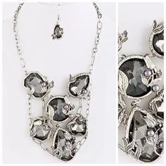"Silver Smokey Gray Crystal Necklace Earring Set Statement  Necklace  Really beautiful necklace sure to dress up even the most simple outfit.  Silver tone metal adorned with large smoky crystals.  This is a very large statement piece.  The details are absolutely stunning.  Lobster clasp.  Matching earrings.  12"" long. ‼️ PRICE FIRM UNLESS BUNDLED WITH OTHER ITEMS FROM MY CLOSET ‼️ Handmade Jewelry Necklaces"