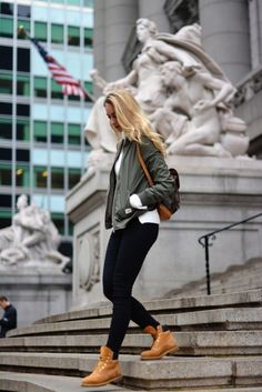 If you're looking for a smart/casual way to wear Timberland boots, Vanessa Ciliberto is showing you the answer! Combine fresh Timberlands with skinny black jeans and a khaki bomber to achieve this effortlessly chic look! Shoes: Timberlands, Jeans: Topshop, Backpack: Louis Vuitton.