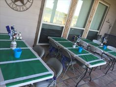 """Football tables for Dallas Cowboys baby shower with buckets of crayons for the kids to draw on the """"field"""""""