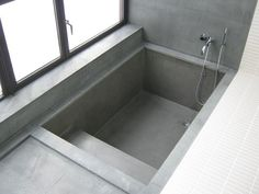 Sunken tub with steps. Not so much the color and materials but that it's got good access.
