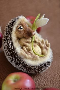 this site is in Russian but the pictures tell it all, instructions on how this beautiful little hedgehog was made, enter the site into a translator if you'd like more