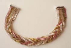 """This is a Delica bead looming project. This bracelet is made using five colors of Delica beads. During the process of making this bracelet, you will learn how to set up the loom how to hide the ends once your bracelet is completed. This is a most delicate looking bracelet that I'm certain you will enjoy for many years to come. So what makes the Mystery Bracelet a """"mystery"""" you ask? Like any good puzzle, you'll have to wait until the end of the looming process for the answer."""