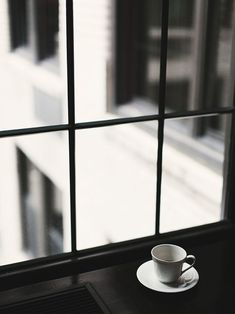 Photography inside the cafe - coffee cup by the window