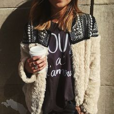 Love the mix of a this fancy fuzzy piece with a simple t-shirt. Coffee in hand is always a plus.