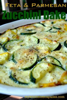 Feta  Parmesan Zucchini Bake 6-7 medium zucchini or yellow summer squash 2 Tb canola oil 2 Tb minced garlic 2 tsp dried thyme 4 eggs 2/3 C light sour cream 1 C crumbled feta cheese 1/2 C fresh parmesan cheese 2 Tb lemon juice salt and pepper