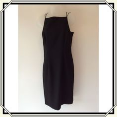 Very elegant black dress. Dressy black dress. Rhinestone detailing on the back. Crisscross straps. Very pretty comes down to the knee and is fully lined Dresses