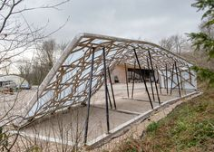 Wood shelter with lattice roof by Architectural Association students