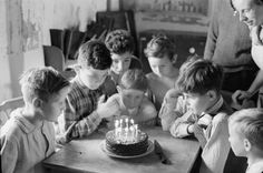 1943: A little boy blows out his candles, surronded by friends-- fellow evacuees from London and Belgium - Found via The Passion of Former Days