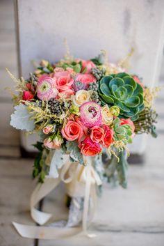 lush ranunculus, rose, and succulent bouquet