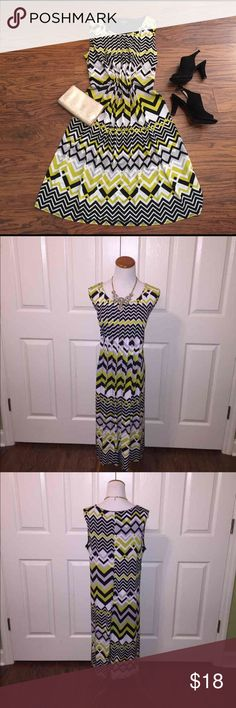Geo print dress Size 14W. Beautiful pleated dress in chartreuse, black, white, and grey. Lined top. Polyester/spandex blend. First picture shows dress pinned to fit mannequin, second and third pictures show actual shape. Glamour Dresses Midi