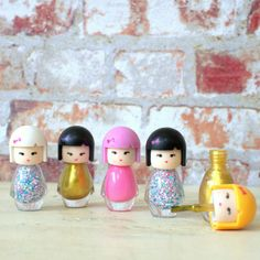 Cute Kimono Doll mini nail polishes.Three colours available , Gold , Pink and Multi coloured Clear Available to buy as a set of 2 or as a set of 5 at a reduced price.These gorgeous little nail polishes come packaged as cute little cartoon Kimono dolls with different little facial expressions and hair colours. They come in three colours , gold, pink and glitter multi- coloured as shown and the lids are easy for little hands to twist off and apply. They are very decorative and would make…