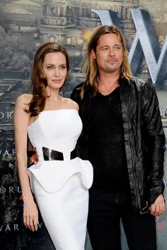 BERLIN, GERMANY - JUNE 04:  Angelina Jolie and Brad Pitt attend the premiere of 'World War Z' at Sony Centre on June 4, 2013 in Berlin, Germany.  (Photo by Luca Teuchmann/WireImage) via @AOL_Lifestyle Read more: http://www.aol.com/article/entertainment/2016/09/26/jennifer-aniston-evil-eye-necklace-brangelina-divorce/21479570/?a_dgi=aolshare_pinterest#fullscreen