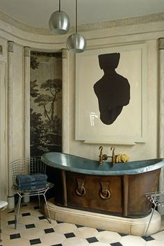 Decorator Frédéric Méchiche has used a scenic grisaille wallpaper, created by Joseph Dufour et Cie in the early nineteenth-century, in this Directoire-style scheme in Paris. Try Zuber for similar styles.
