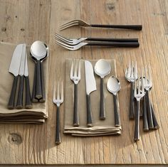 """We love our flatware's rustic refinement, the polished tines and bowls meeting rough-hewn, blackened handles. Artisans forge the collection by hand from single, solid pieces of stainless steel. Place setting includes four each of knives, dinner forks, salad forks, soup spoons and teaspoons. Hand wash only. Exclusive. 6-3/4"""" to 9-1/2""""L."""