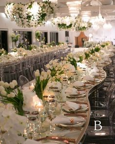 Creating a unique shared seating formation, where our bride and groom were amongst their family and friends. Reflective surfaces, crisp florals and rose gold accents created a perfect ambience for a beautiful night. Tulip Wedding, Green Wedding, Elegant Wedding, Our Wedding, Wedding Flowers, Wedding Table Centerpieces, Reception Decorations, Event Decor, Wedding Designs