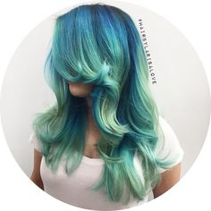 Deep blue root melting to teal to mint.
