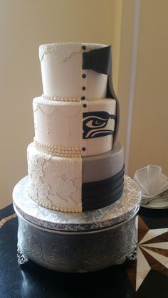Part gorgeous traditional wedding cake, part classy Seahawks masterpiece.  This cake was such a hit!