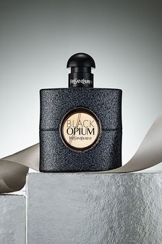 Black Opium Fragrance. The hedonistic black coffee note of the original Black Opium scent is transformed into an ultra-luminous green coffee accord with a heart of Jasmine Tea on a sensual base of sensual Patchouli, white woods and musk. Black Opium Eau de Toilette comes dressed in a glittering bottle of deepest pink diamond-dust finish for rock edge and modern glamour, with a radiant rose gold glass heart for soft femininity.