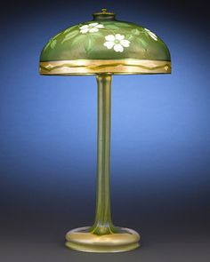 """Extraordinarily Rare Tiffany Studios Favrile Glass Table Lamp Decorated In A Stunning Intaglio-Carved Floral Design, Which Is Rarely Seen On Tiffany Items, Featuring A Rare Iridescent Glass Bordered Shade Atop A Favrile Base With A Pulled Leaf Design - Shade Engraved """"5692J  L.C. Tiffany Favrile""""   c.1915  -  M. S. Rau Antiques"""