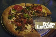 Mellow mushroom has vegan pizza (although the vegan cheese does have casein in it which makes it not 100% vegan).  They also have gluten free crust.  thinking birthday lunch...maybe.