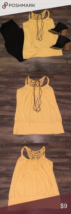 Yellow Crochet Racerback Tank Yellow Racerback Tank with crochet lace detail on back. Banded bottom. Excellent stretch. 95% rayon, 5% spandex. Size large. Charlotte Russe Tops Tunics