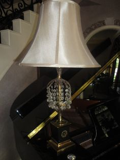 Look beyond the torn or stained lampshade...it's easy to add a new one to a thrift store find!