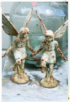 iron fairies...would look sweet in your flower garden