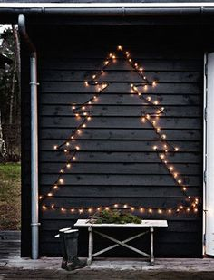 Fake an outdoor Christmas tree with a well-placed twinkly light silhouette.