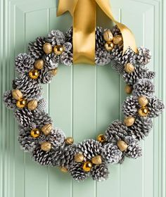 "Gold ""nuggets""—spray-painted walnuts and ornaments—sparkle against pinecones sprayed silver and white. Details: http://www.midwestliving.com/holidays/christmas/pinecone-crafts-and-decorations/?page=14"