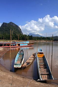 Boats on the Mekong River, near Luang Prabang, Laos Laos Travel, Travel Tours, Luang Prabang, Asia Cruise, Mountainous Terrain, Vientiane, French Colonial, Laos People, Southeast Asia