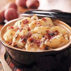 Baked German Potato Salad Recipe -What makes this German potato salad so different is that it's sweet instead of tangy. During the holidays, my family has an annual ham dinner, and I always prepare it.  The first time I took it to work, people kept coming out of their offices to find out what smelled so good. By lunch, it was gone. Now I make a double batch to take to work! —Julie Myers, Lexington, Ohio