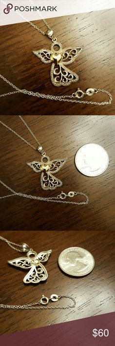 """AN ANGEL WITH A HEART OF GOLD, LITERALLY A beautiful angel with a heart of gold, literally.  18"""" sterling silver chain with a 1 1/4"""" sterling silver angel with a heart of 10K gold.  The chain is clearly marked 925, and the angel is also clearly marked 925 - 10K AU on the back of one of the wing's edge.  AU is the international symbol for gold. Jewelry Necklaces"""