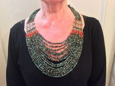 THE SAME NECKLACE WORN...