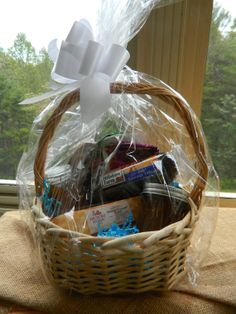 A Foodie Snack Pack Gift Basket filled with Goodies like Jam, Sausage, Cheese, Honey and Hot Cocoa
