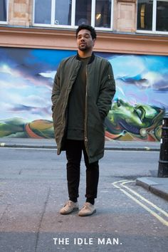 Men's street style, wear a long-line camo green bomber with a long line tee underneath, add black jeans and throw on some beige brogues for a neutral look.   Shop men's clothing at The Idle Man