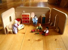waldorf folding dollhouse- great for taking camping or hotel stays (just leave some of the tiny pieces at home)