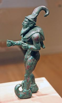 Proto-Elamite bronze figure af a man, 3000 B.C. This solid-cast sculpture is one of a pair of nearly identical images of a hero or a demon wearing the upturned boots associated with highland regions, his power enhanced by the mighty horns of the ibex.