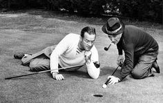 Bob Hope admires Bing Crosby's putting technique during a photo session for the Los Angeles Times on Jan. 25, 1946.