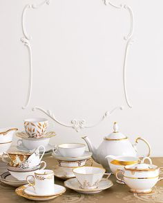 Gilded patterns mix & match seamlessly. Back row, from left: Jug: Royal Crown Derby; top teacup & saucer: Royal Limoges, bottom: Royal Copenhagen. Middle: top teacup, first stack: RCDerby, bottom sets: the Martha Stewart Collection with Wedgwood; top set of second stack: Mottahedeh, bottom: Royal Crown Derby; teapot: Anna Weatherley; creamer: Wedgwood. Front: Demitasse set: Marc Jacobs Waterford, bottom saucer: Royal Crown Derby; teacup set: Porzellan Nymphenburg; sugar bowl: Royal Crown…