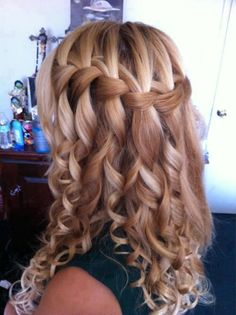 "A waterfall braid w/ the ""down pieces"" curled with a wand."